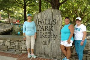 Falls Park South Carolina Women With Sign