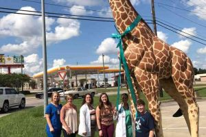 Pass Christian Mississippi Giraffe Statue Ribbon Group Photo